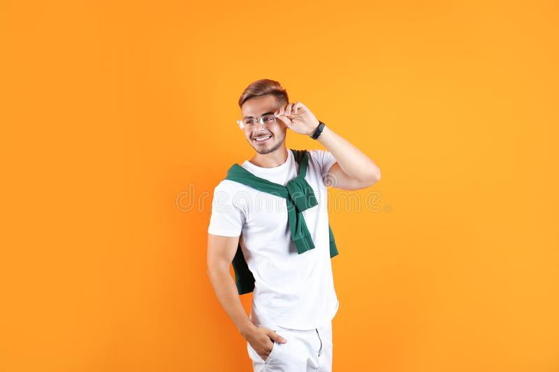 Young man with trendy hairstyle. On color background royalty free stock photography