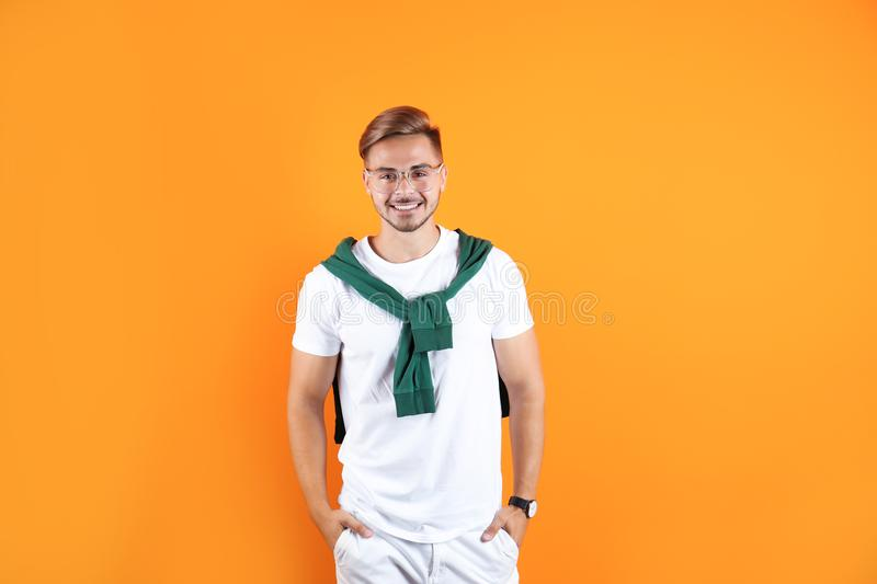 Young man with trendy hairstyle. On color background stock photo