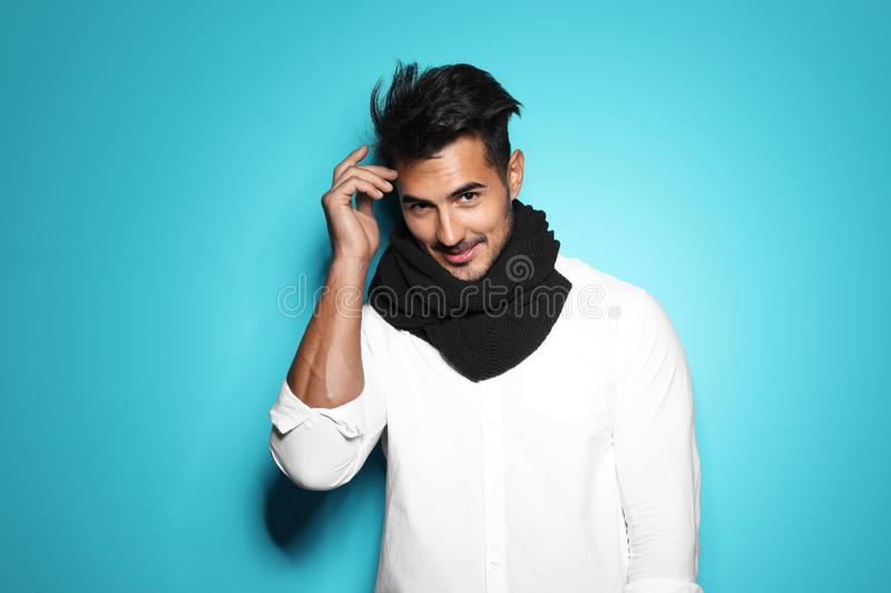 Young man with trendy hairstyle posing. On color background stock images