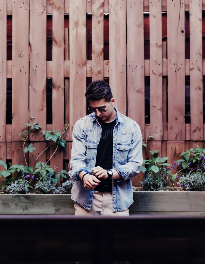 Young man in a trendy summer jacket in a stylish black t-shirt royalty free stock photos