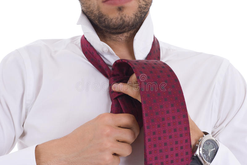 Young man tying a knecktie stock photo