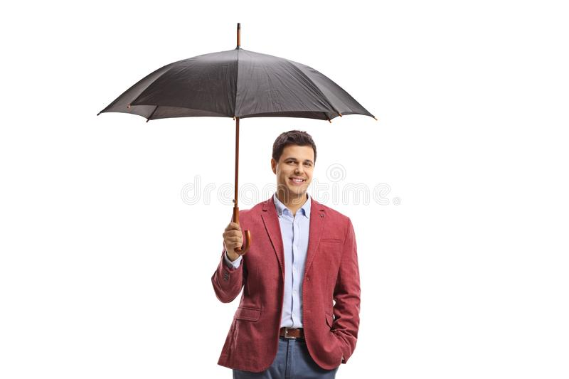 Young man with an umbrella stock images