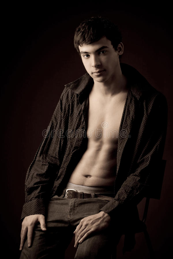 Young man with unbuttoned shirt royalty free stock photos