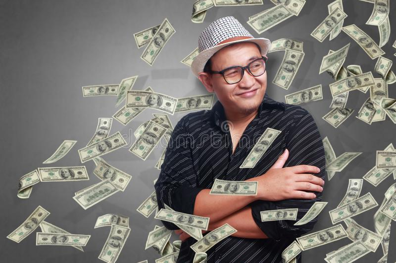Young Man Under Rain of Money royalty free stock images