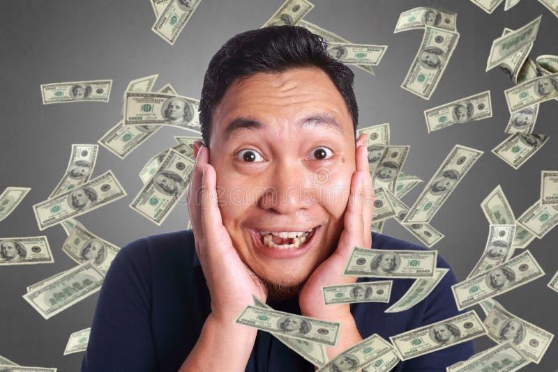 Young Man Under Rain of Money stock photo