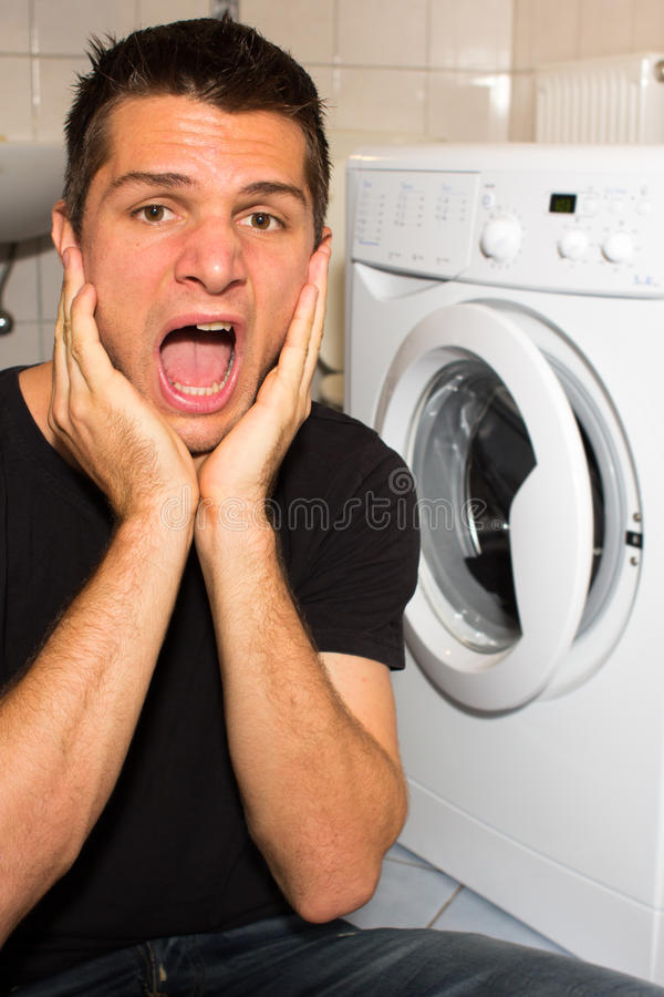 Download Young Man Unhappy With Washing Mashine Stock Image - Image: 21682051