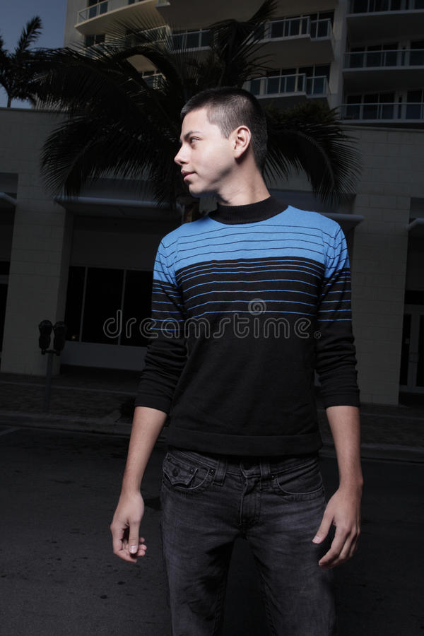 Young man in an urban setting royalty free stock image