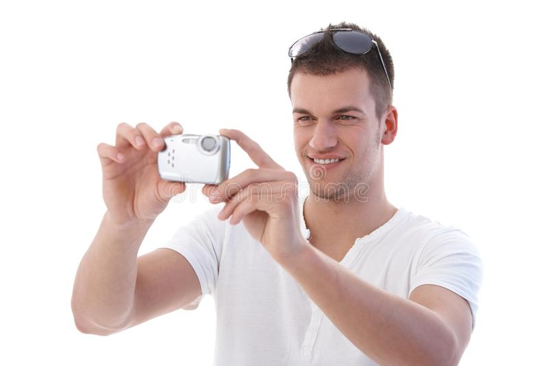 Download Young Man Using Digital Camera Smiling Stock Photo - Image: 19506658