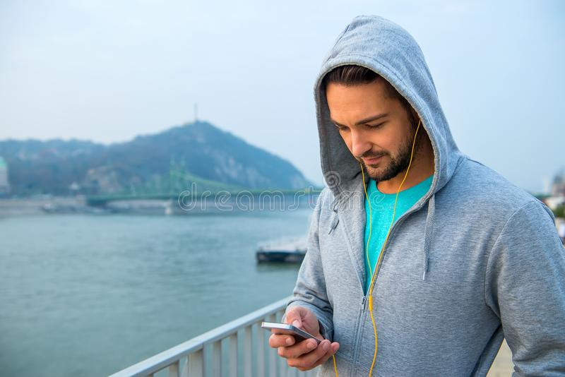 Young man using his phone stock photo
