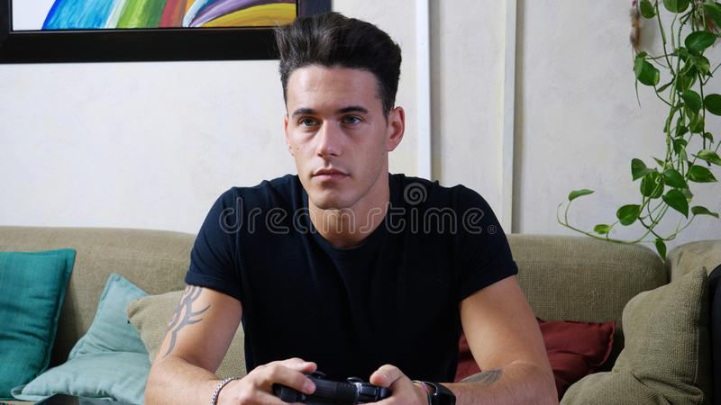 Young man using joystick or joypad for videogames royalty free stock photography