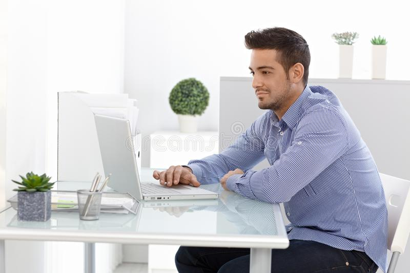 Young Man Using Laptop Computer Royalty Free Stock Photography