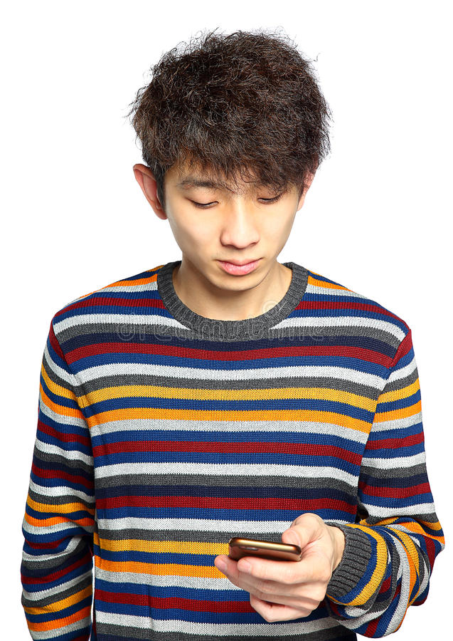 Young man using mobile phone texting stock images