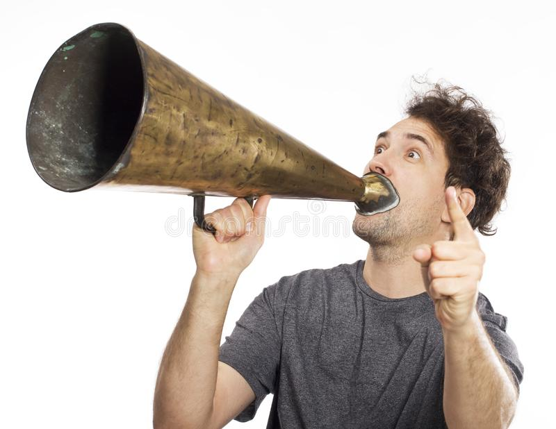 Young man using an old megaphone royalty free stock photo