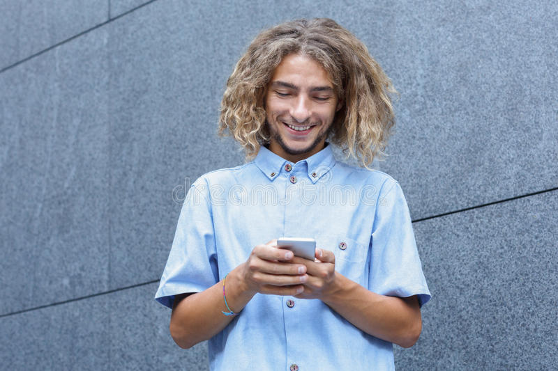 Young man using smartphone stock image