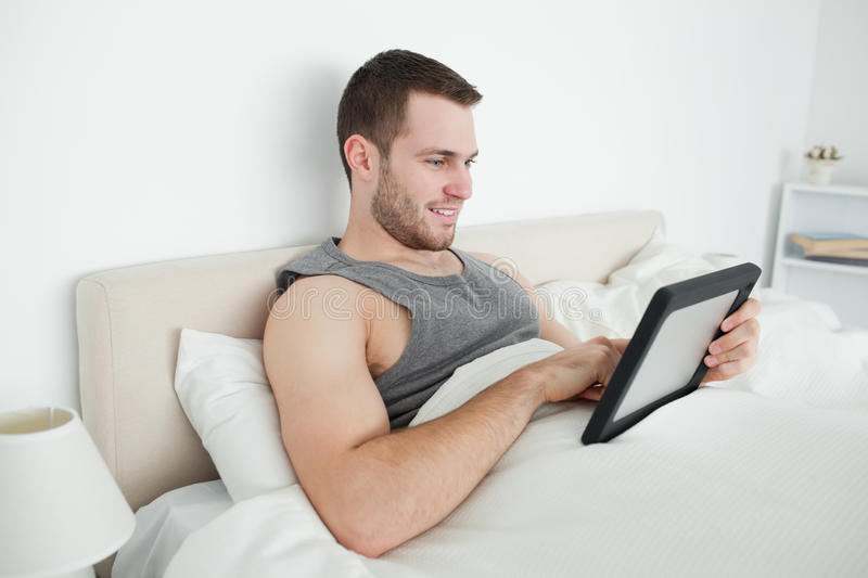 Young man using a tablet computer stock images