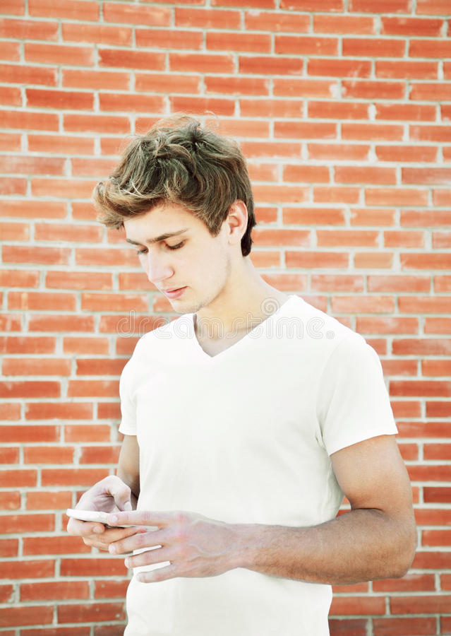 Young man is using a tablet. Outdoors royalty free stock photos