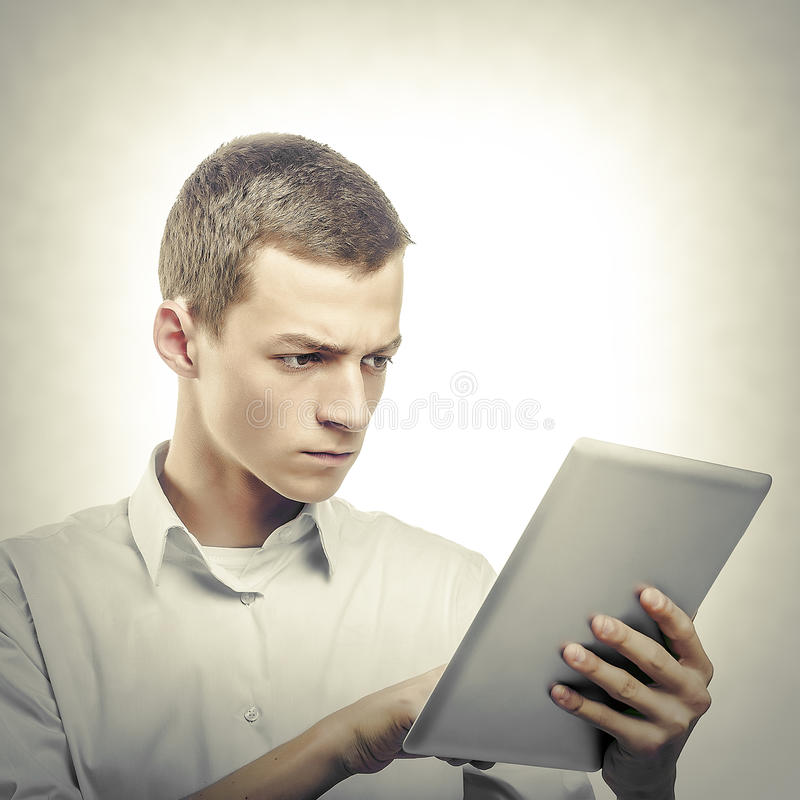 Young man using tablet pc stock images