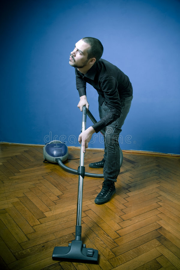 Young man with vacuum