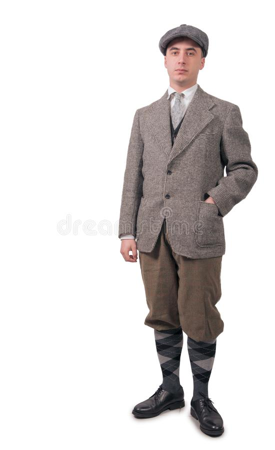 Young man in vintage clothes with hat, 1940 style, on white stock image