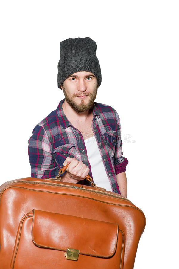 Young man with vintage leather suitcase isolated on white background royalty free stock photography