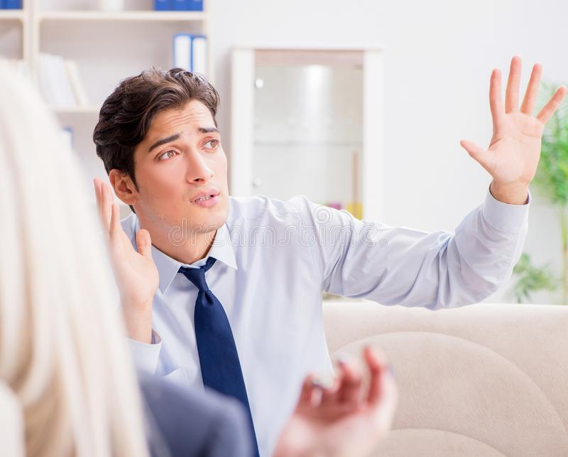 Young man visiting psychiatrist doctor for consultation. The young men visiting psychiatrist doctor for consultation stock photos