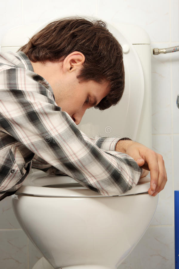 Young man vomiting. Young man (drunk or sick) vomiting royalty free stock photos