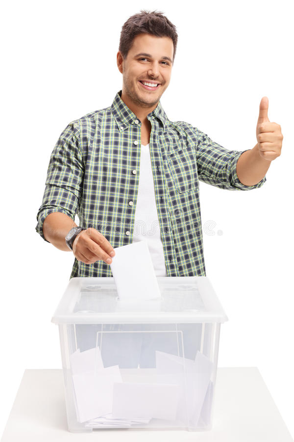 Young man voting and making a thumb up sign. On white background royalty free stock image
