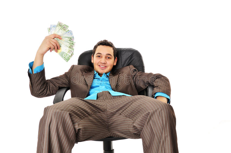 Young Man With Wad Of Money Stock Image