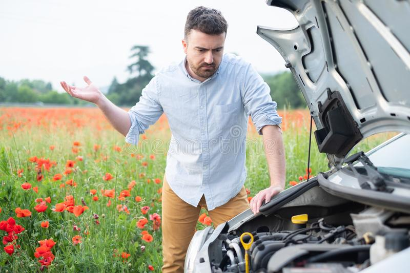 Portrait of stressed man waiting for service his breakdown car stock images