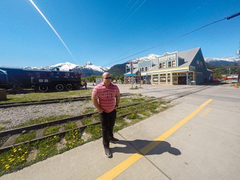 Young man waiting at a train platform stock image