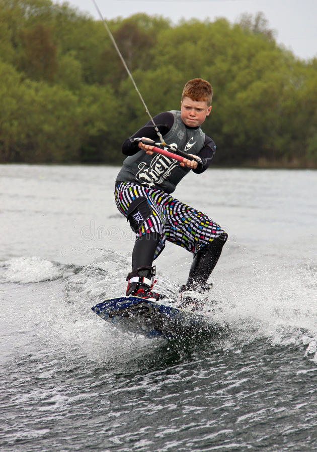 A young man wake-boarding / surfing stock images