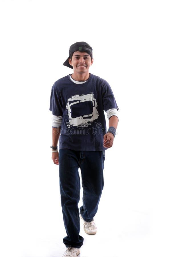 Young man walking royalty free stock photography