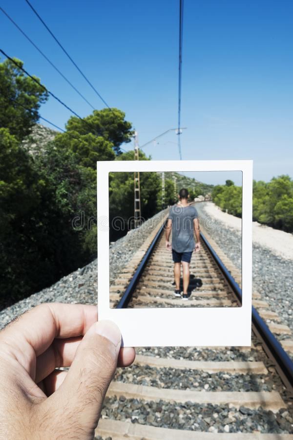 Free Young Man Walking By The Railroad Tracks Royalty Free Stock Photography - 130870517