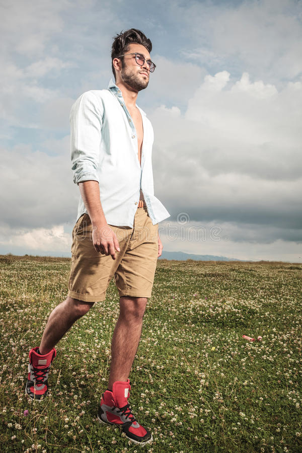 Download Young Man Walking Outside Stock Photo. Image Of Cheerful   49684924