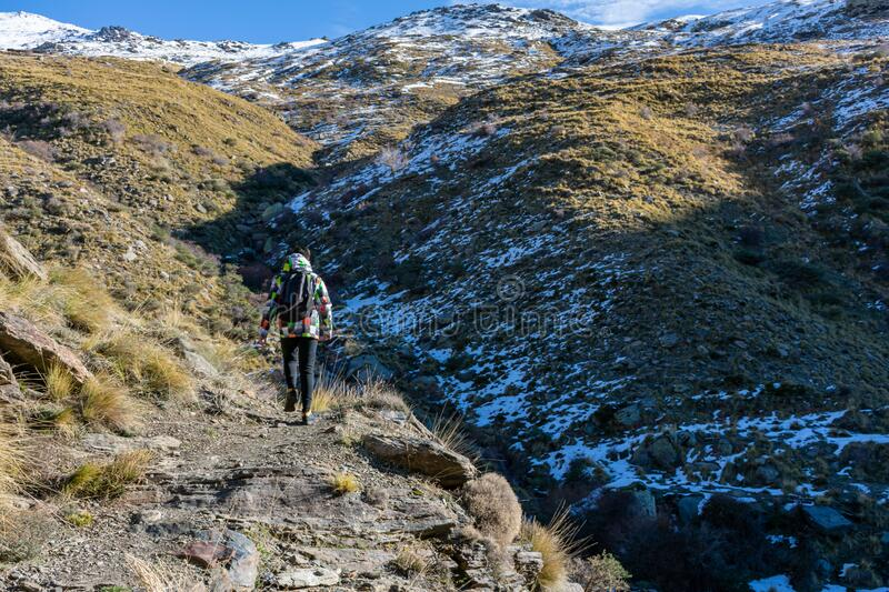 Young man walking. On a path in Sierra Nevada, Spain royalty free stock photos