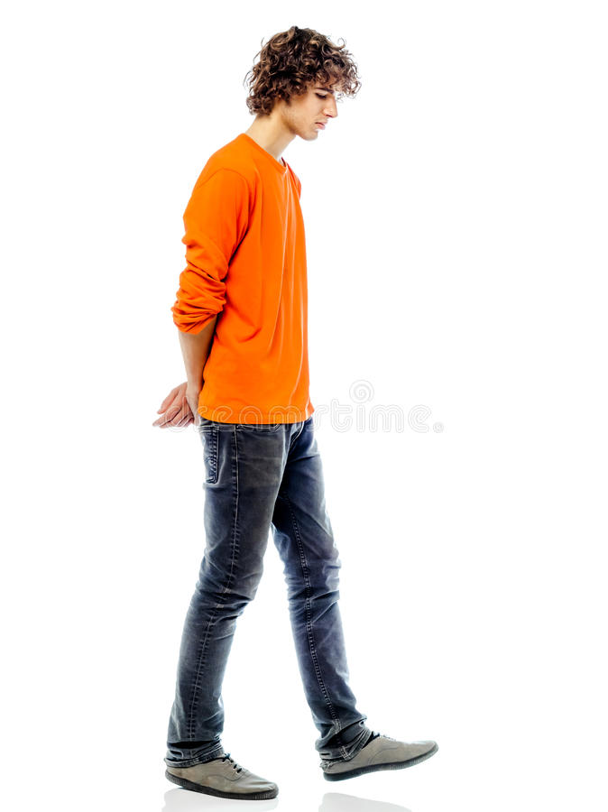 Young man walking sad bore side view royalty free stock photo