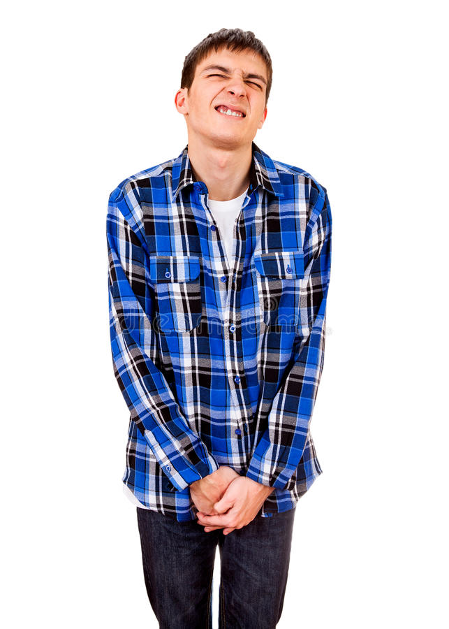 Young Man want to Pee. Isolated on the White Background stock photos