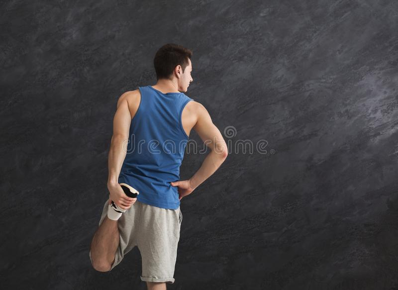 Young man warming up before training, back view stock photos
