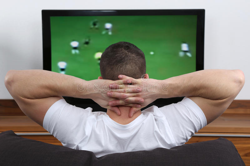 Download Young Man Watching Football On Tv Stock Photo - Image: 37380074