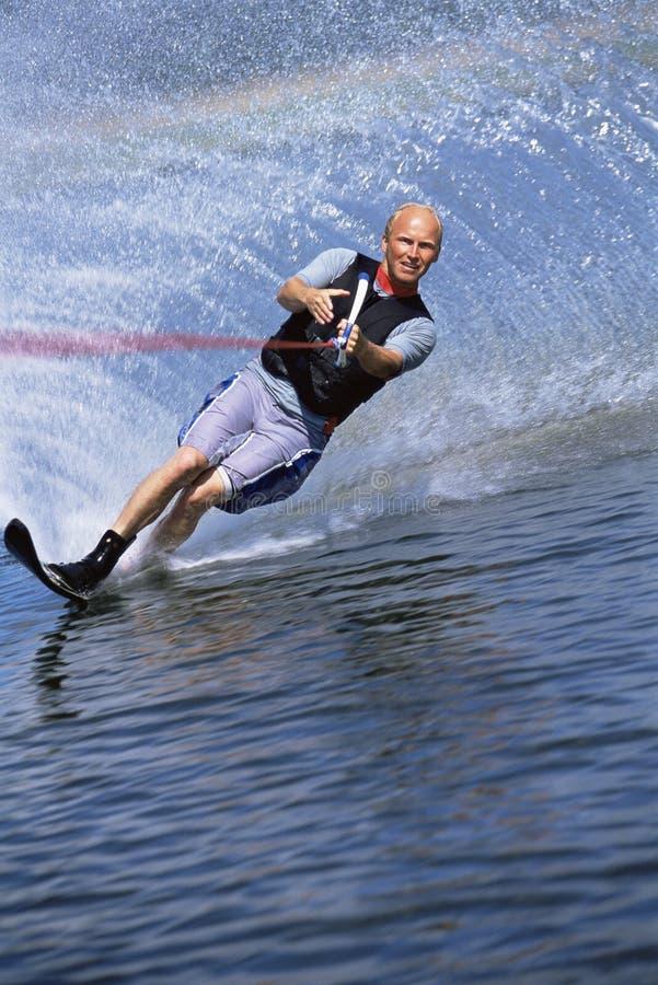 A young man water skiing stock photos