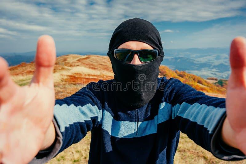 Young man wearing black balaclava looking at the camera stock images