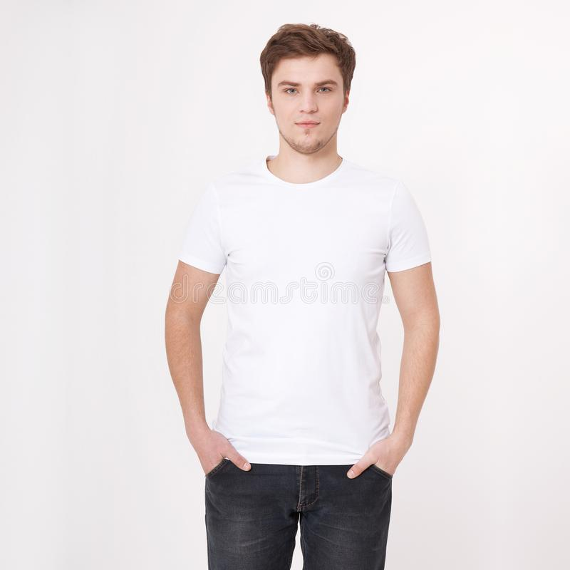 Young man wearing blank white t-shirt isolated on white background. Copy space. Place for advertisement. Mock up. Young man wearing blank white t-shirt isolated stock images