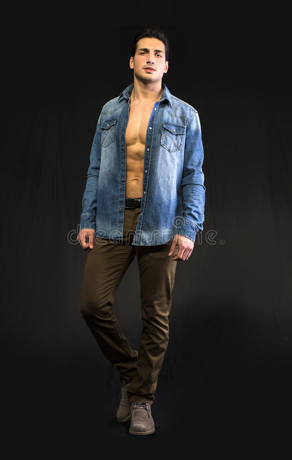 Young man wearing denim shirt open on naked chest royalty free stock photo
