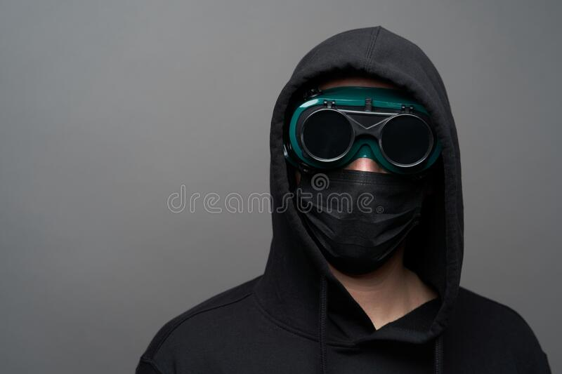 young-man-wearing-face-mask-protective-glasses-young-man-wearing-face-mask-protective-glasses-handsome-man-black-hoodie-177303605.jpg