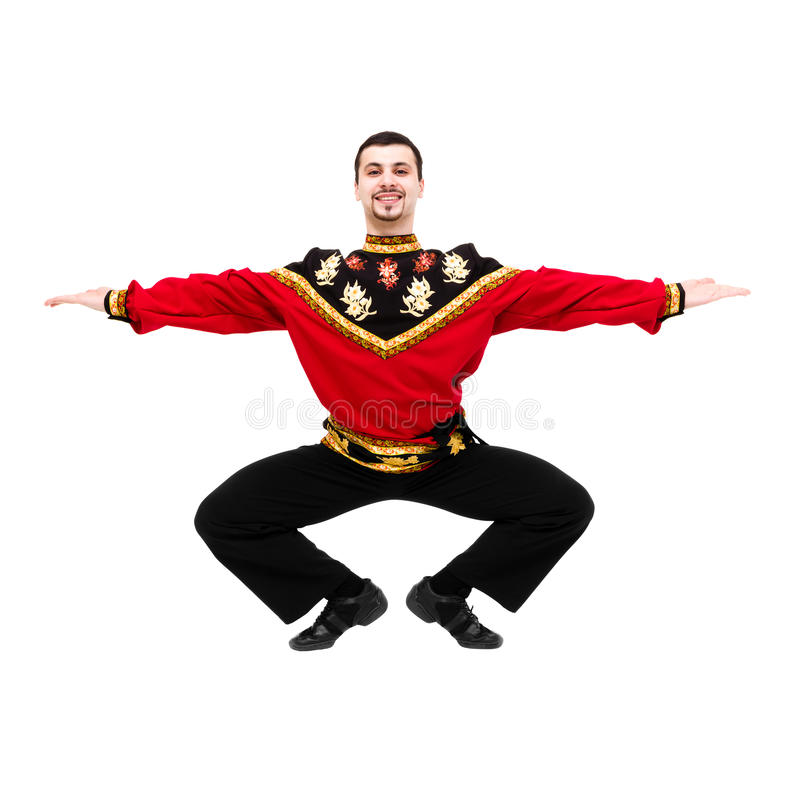 Young man wearing a folk russian costume dancing stock photo