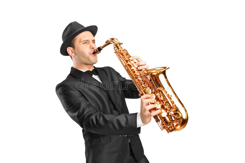 Young man wearing hat and playing on saxophone stock images