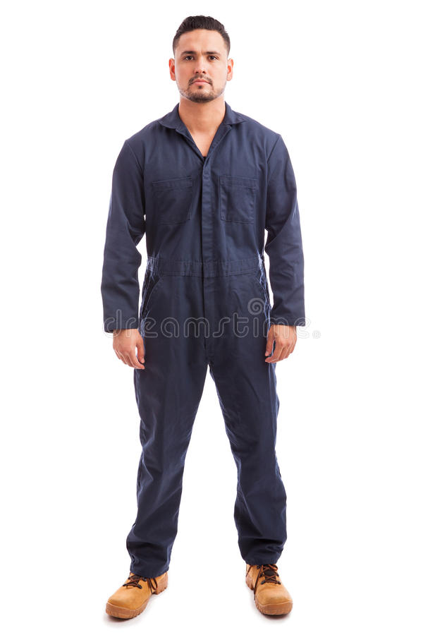 Young man wearing overalls royalty free stock photos