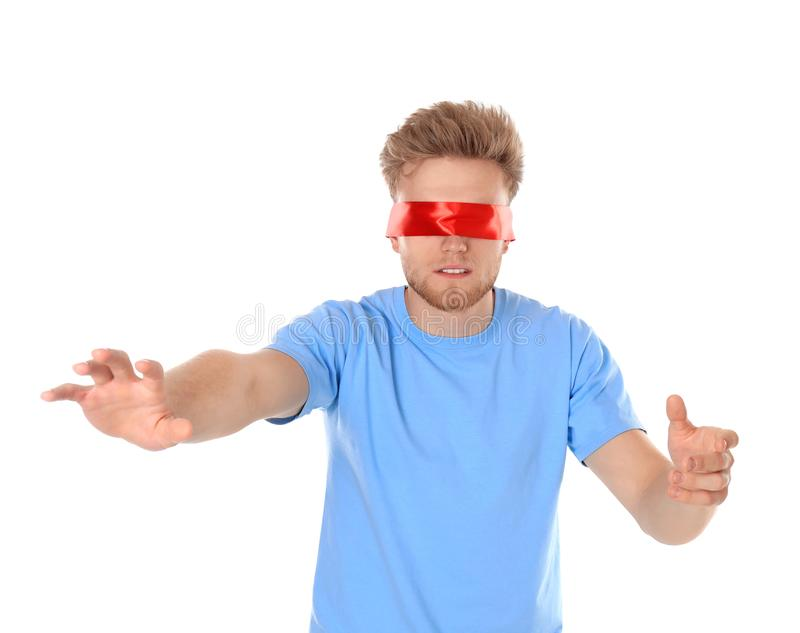 Young man wearing red blindfold on white royalty free stock image