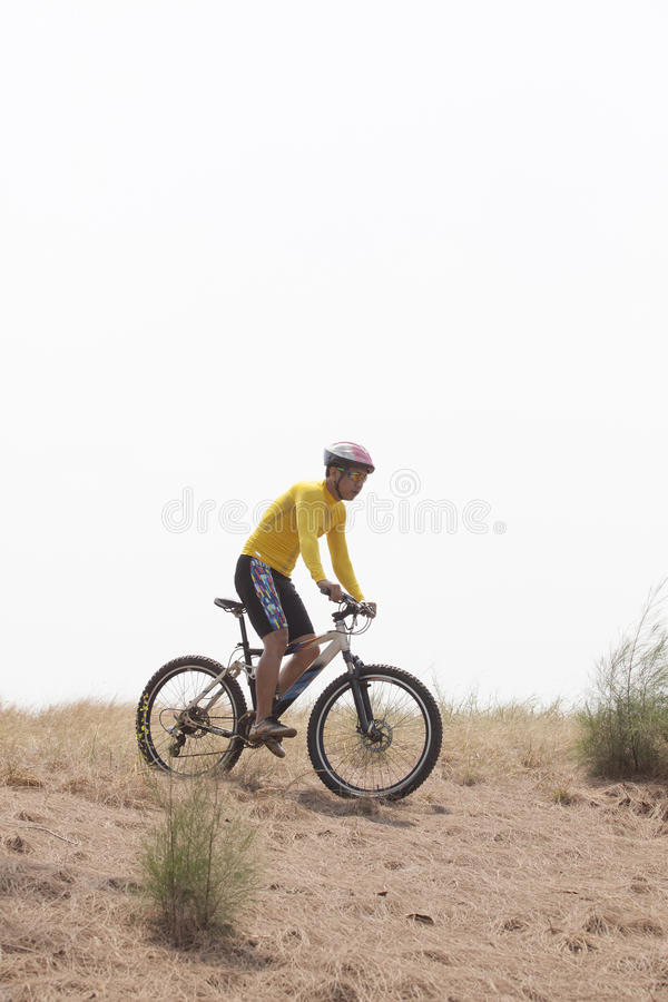 Free Young Man Wearing Rider Suit Riding Mountain Bike MBT On Dusty R Royalty Free Stock Photo - 47605855