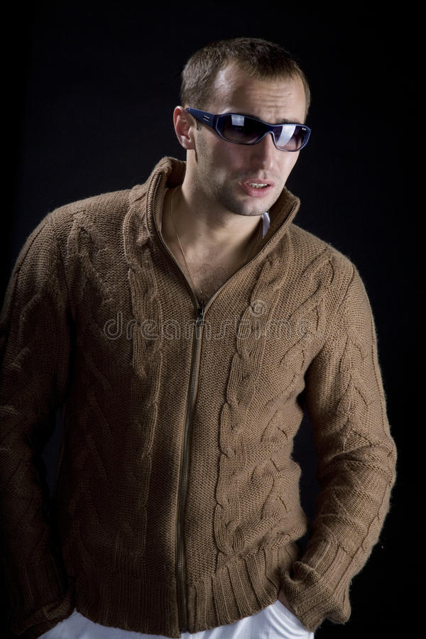 Young man wearing sunglasse. S on a black background royalty free stock image